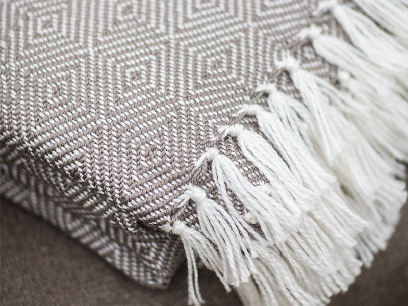 Beautiful grey and white throw with diamond pattern