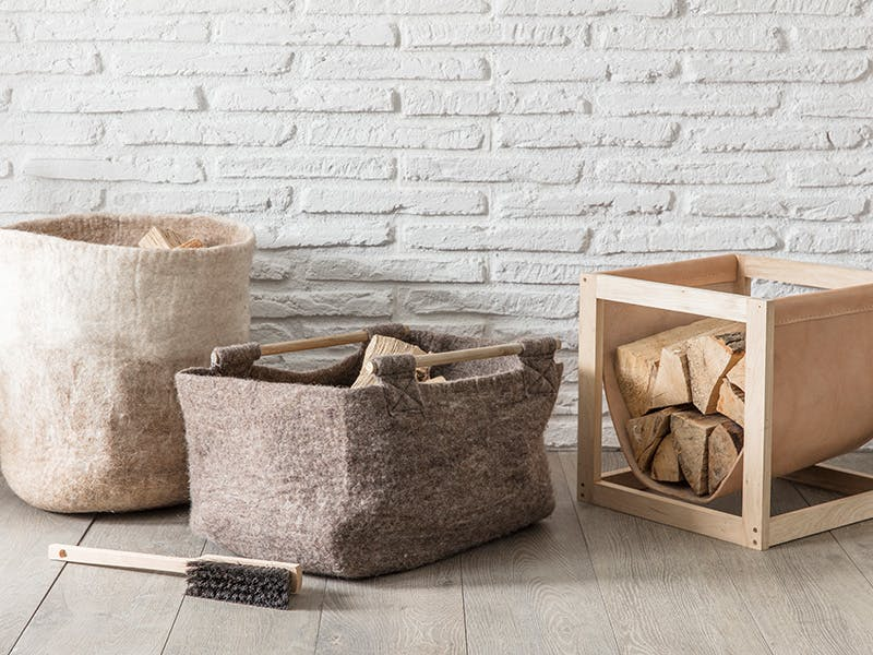 Fairtrade felt baskets and oak and leather log holders filled with wood