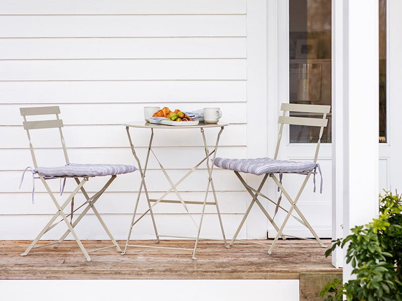 Small Bistro set in Clay on wood-decked patio