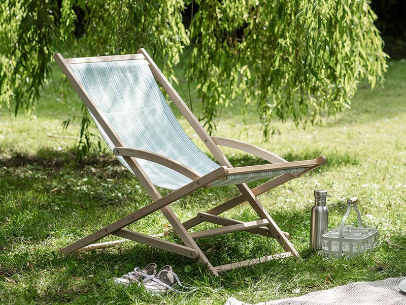 Peppermint Rocking Deckchair on the grass underneath a willow tree