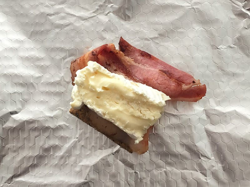 Camembert layered onto bacon and a cracker