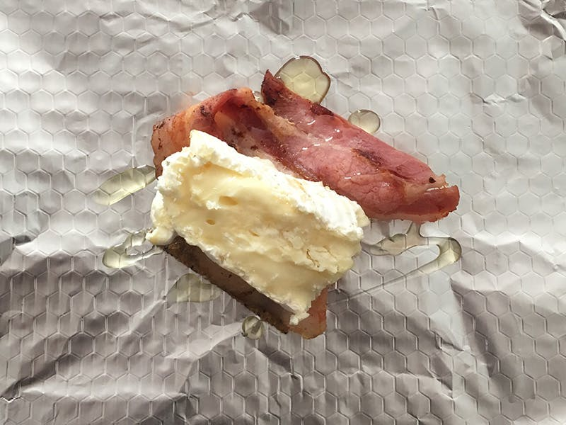 Maple syrup drizzled on camembert and bacon