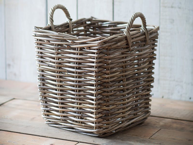 Rattan Square Basket on a wood panelled floor