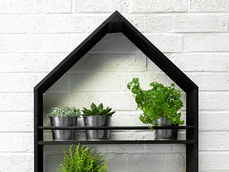 Moreton Pitched Roof Pot Holder containing galvanised pots filled with herbs and plants