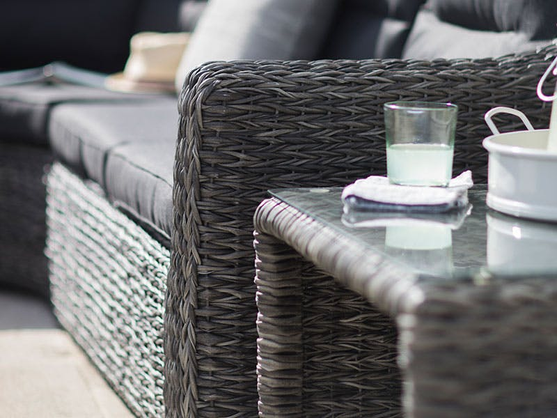 Inviting sofa with a cool glass of lemonade in the sunshine