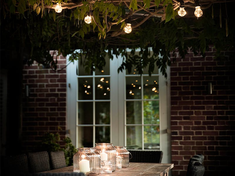 Festoon lighting in romantic back garden setting